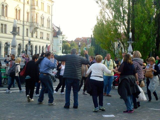 People dancing in the main square of Ljubljana